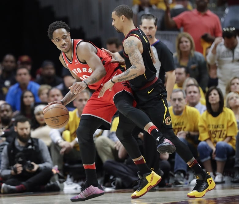 37ccfb28d56 Toronto Raptors  DeMar DeRozan attempts to drive on Cleveland Cavaliers   George Hill. DeRozan was ejected from Game 4 after being called for a  flagrant-2 ...