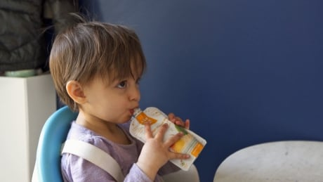 Isla eating squeeze pouch