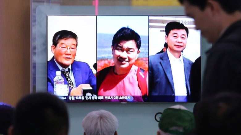 3 Americans released from North Korea on way home to U S