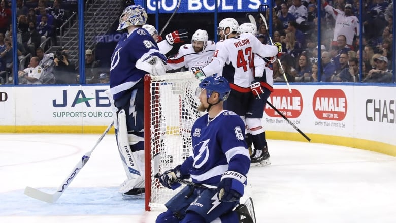 d4db7e5b39b Tampa s Anton Stralman (6) and Andrei Vasilevskiy endure another Washington  celebration in the Lightnings s 6-2 loss to the Capitals in Game 2 on  Sunday.