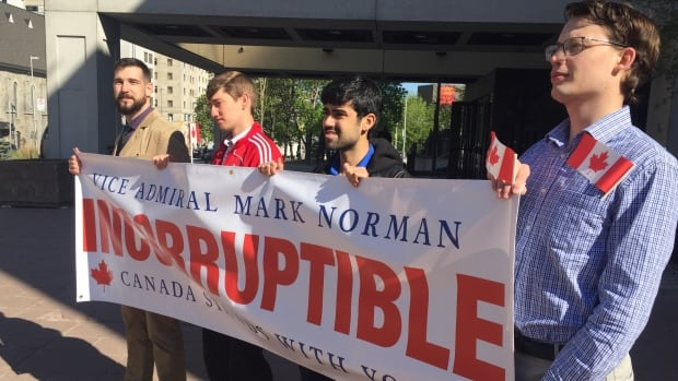 Supporters rally as lawyers argue court dates in Vice-Admiral Norman's case