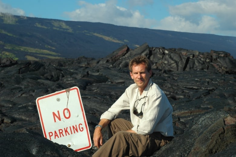 George Kourounis sits at Kilauea Hawaii in 2006 during a visit to the volcano