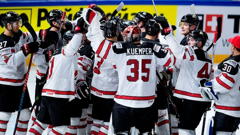 2233ea45b52 Canada celebrates its overtime win over Russia Thursday at the world hockey  championships in Copenhagen. (Liselotte Sabroe AFP Getty Images)