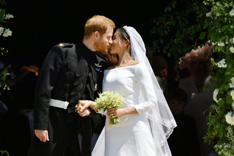 Prince Harry and Meghan Markle kiss on the steps of St George s Chapel in  Windsor Castle after their wedding Saturday. (Ben Birchhall Associated  Press) de0400e01e6a