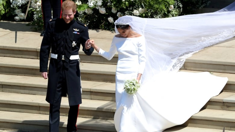 meghan s wedding dress prince harry s military uniform and what the guests wore cbc news meghan s wedding dress prince harry s