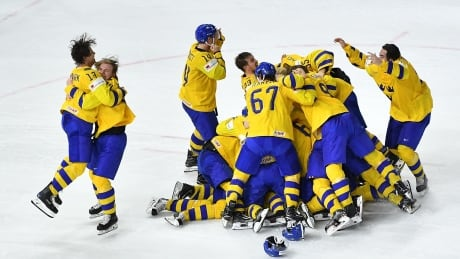Sweden defends hockey worlds title with shootout win over Switzerland