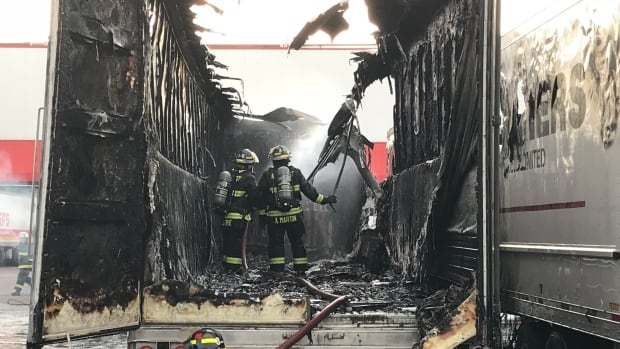 Amherst fire destroys pickup truck and 3 transport truck trailers