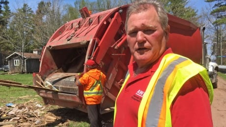 Flood debris pickup at Grand Lake has company working flat-out