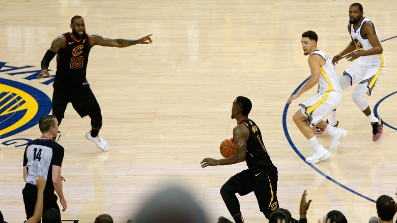 cd8891a4ff569e Cleveland Cavaliers guard J.R. Smith, centre, made a costly blunder at the  end of regulation which ultimately cost his team Game 1 of the NBA Finals.