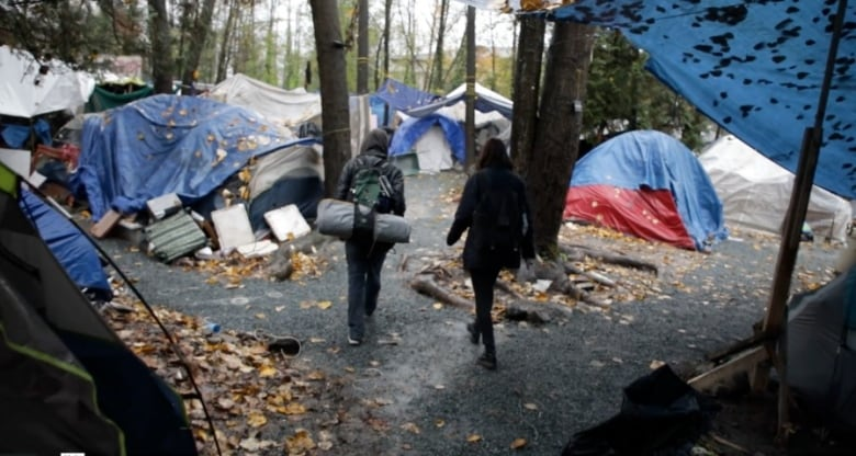Tent city campers find strength together, fend off contempt and Molotov cocktails
