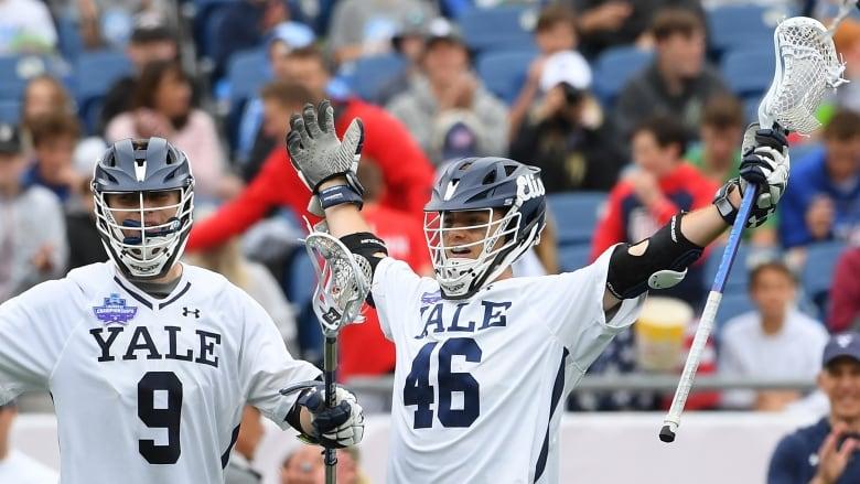 61654652999 Saskatoon s Brendan Rooney ( 46) celebrates scoring a goal in the NCAA  men s lacrosse national championship. Rooney and Yale University beat Duke  13-11 to ...