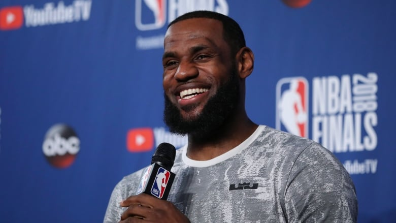 dc6cd3c2bdac Cleveland s LeBron James smiles during a press conference Thursday ahead of  Friday s Game 4 against the Golden State Warriors.