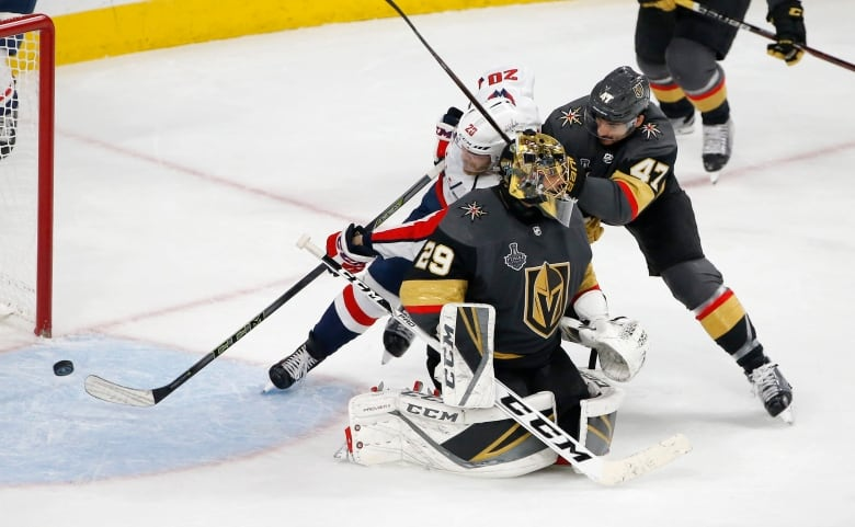 Washington s Lars Eller scores what proved the Stanley Cup-winning goal  past Vegas goaltender Marc-Andre Fleury and defenceman Luca Sbisa. 6b16f9ae0c5