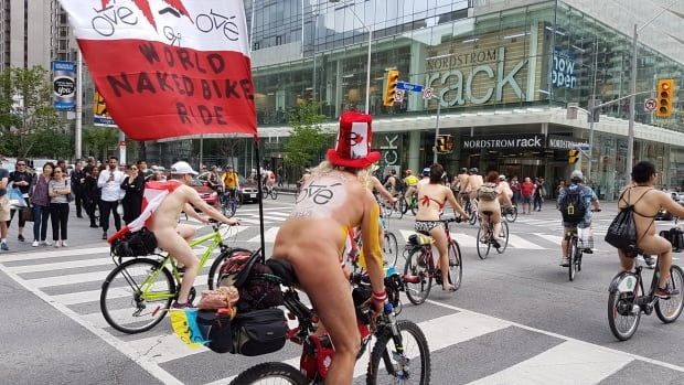 Annual World Naked Bike Ride bares it all in Toronto | CBC News