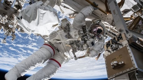 astronauts perform successful spacewalk to set up tv cameras for arriving spacecraft