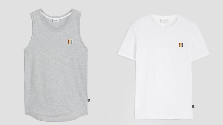 225cdb5caadb5 The Pride-inspired white T-shirt and grey tank top were made by  Petites-Mains