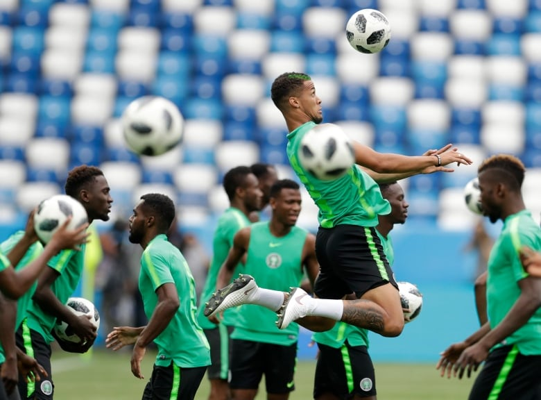 db87b3fb9 Nigeria s William Ekong heads the ball during Nigeria s official training  on the eve of the match between Croatia and Nigeria at the 2018 World Cup.