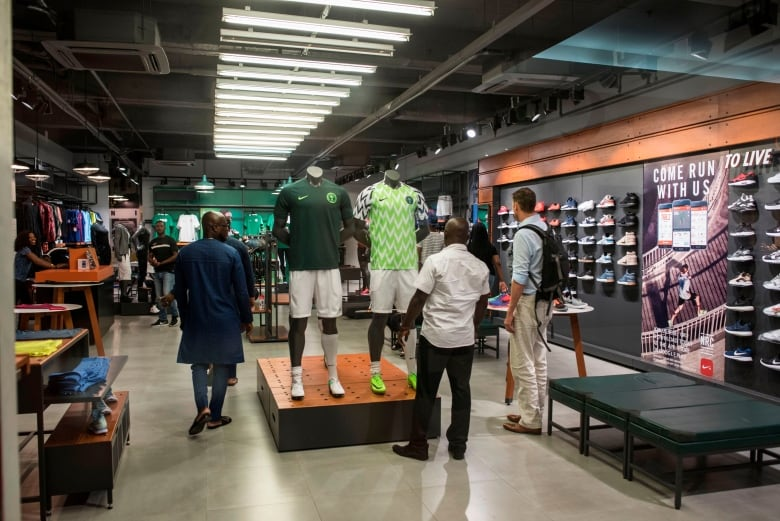 ce4f6b4c2 Customers look at a Nigerian World Cup jerseys in a Nike store in Lagos on  June 4