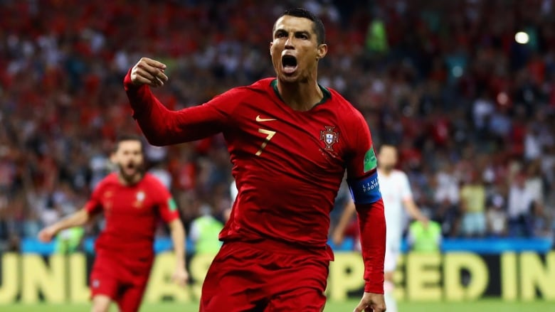 49e9083e4fd Cristiano Ronaldo of Portugal celebrates scoring his team s first goal in a  Group B match against Spain in Russia on Friday. The soccer star s hat trick  in ...