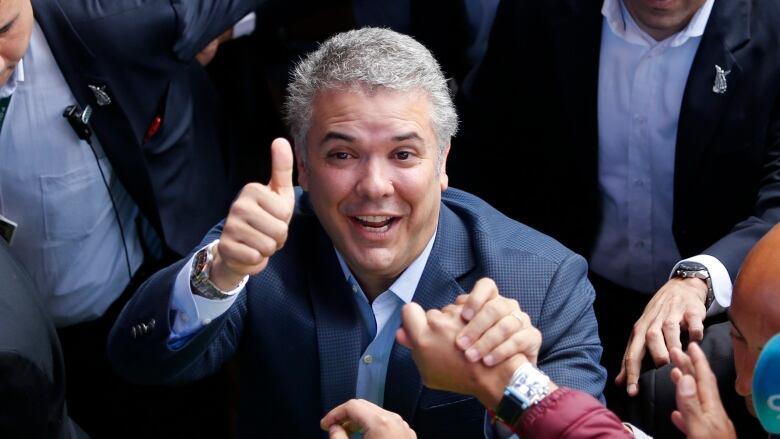 Conservative lawmaker Ivan Duque wins Colombia's presidential ...