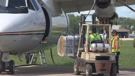 Fridges and freezers get loaded on plane for Manitoba First Nations