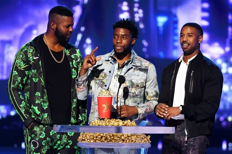 Black Panther co-stars, from left, Winston Duke, Chadwick Boseman, and Michael B. Jordan accepted the Best Movie trophy for their film.(Kevin Winter/Getty Images for MTV)