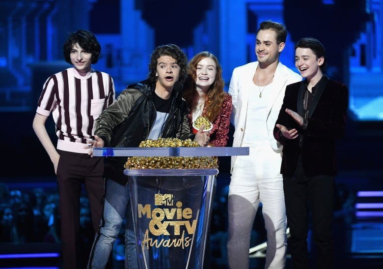 Stranger Things was named Best Show, with cast members Finn Wolfhard, from left, Gaten Matarazzo, Sadie Sink, Dacre Montgomery, and Noah Schnapp accepting the honour.(Kevin Winter/Getty Images for MTV)
