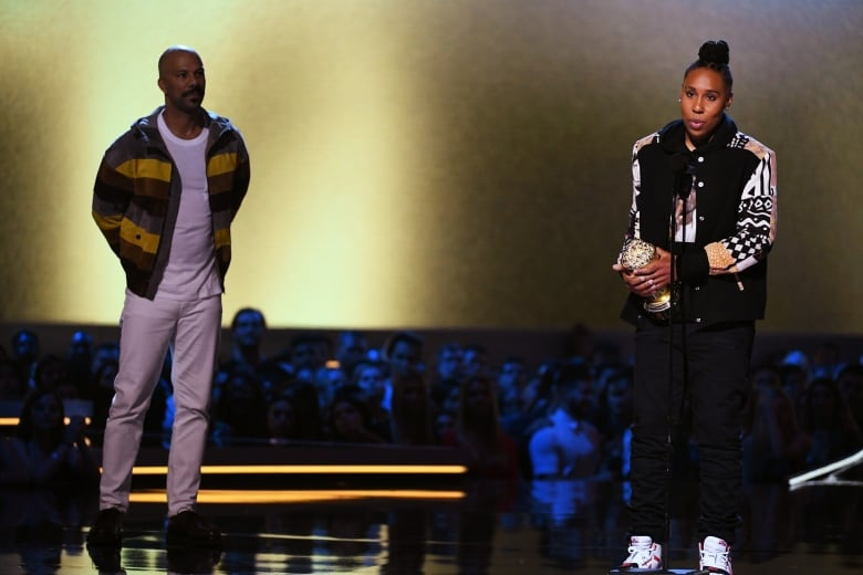 Common, left, presented actor, writer and showrunner Lena Waithe with an MTV Trailblazer Award.(Kevin Winter/Getty Images for MTV)