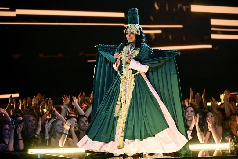 Host Tiffany Haddish donned a parade of different outfits referencing classic film and TV, including The Carol Burnett Show.(Kevin Winter/Getty Images for MTV)