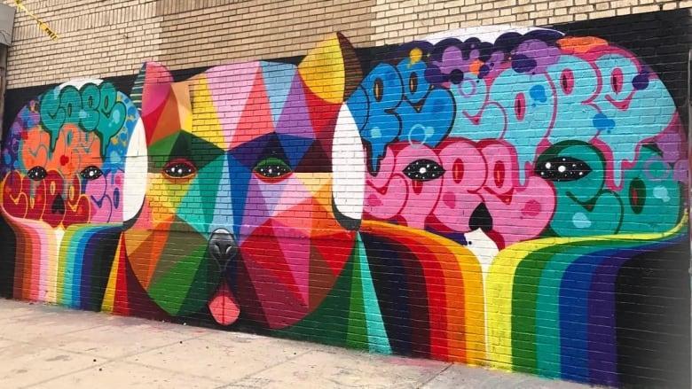 renowned street artist to start 6 storey mural saturday cbc news