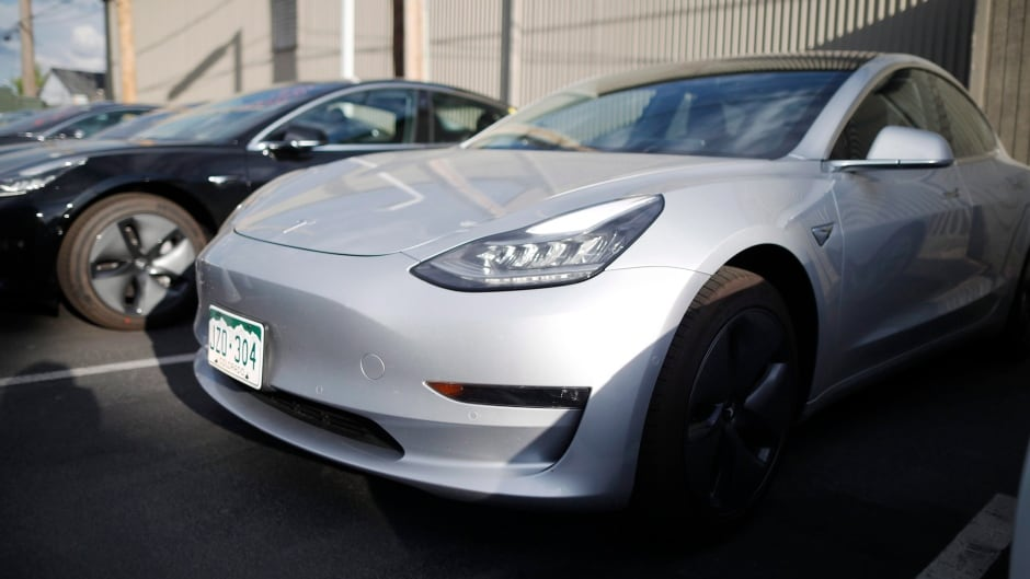 cbc.ca - CBC News - New Tesla owners on hook for $14K after sudden end of electric car incentive program