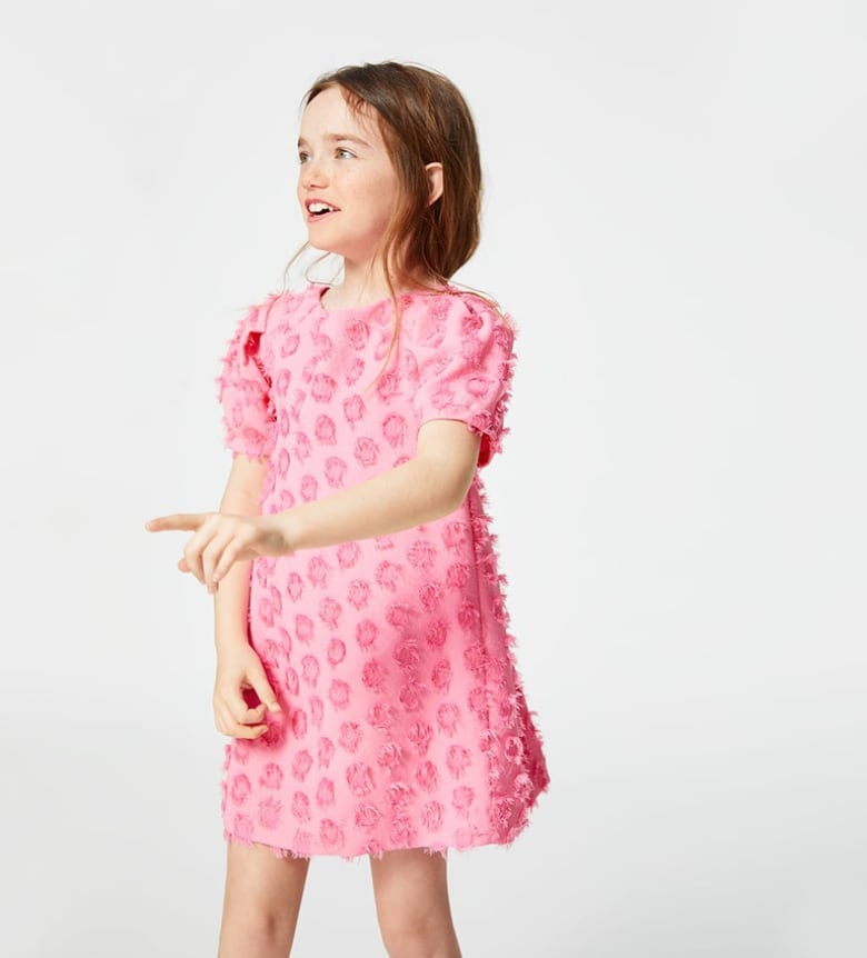 ae6788542 The bubblegum colour, the all-over dotted mesh, the pleats at the back and  on the sleeves — any guest of any age would be challenged to find a more  high ...