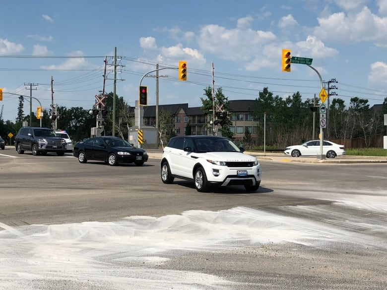 820c0655d4b1 An oil slick shut down Sterling Lyon Parkway Wednesday. (Travis Golby CBC)