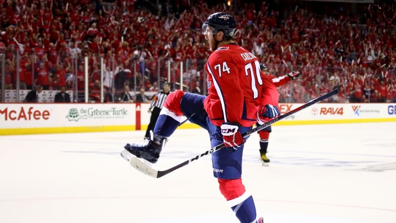 John Carlson of the Washington Capitals re-signed with the team on an  8-year deal worth  64 million US on Sunday. (Gregory Shamus Getty Images) e413a782d7e