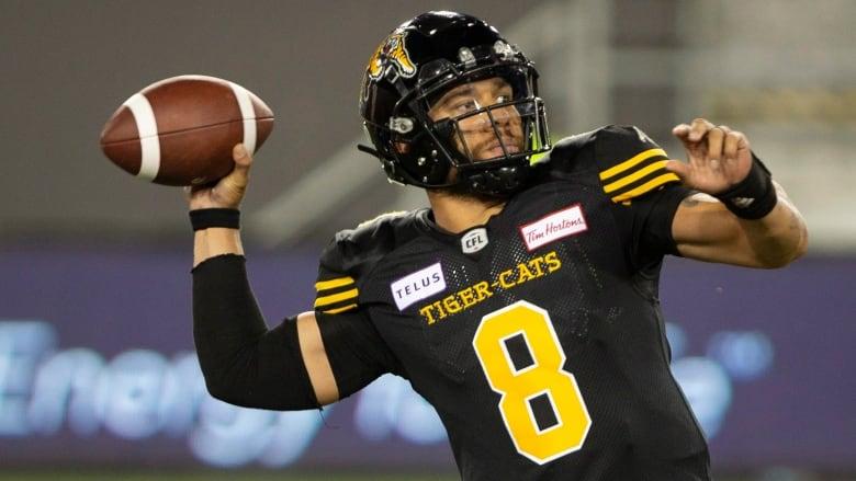 Hamilton Tiger-Cats quarterback Jeremiah Masoli (8) throws during the  second half. (Peter Power The Canadian Press) 9cc47238f