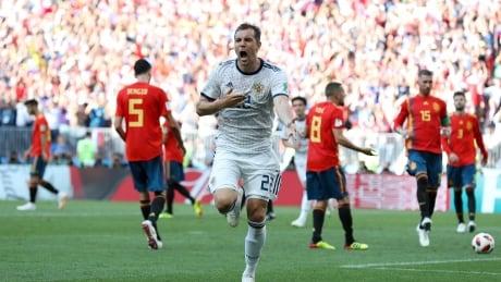 Russia shocks Spain shootout, advances