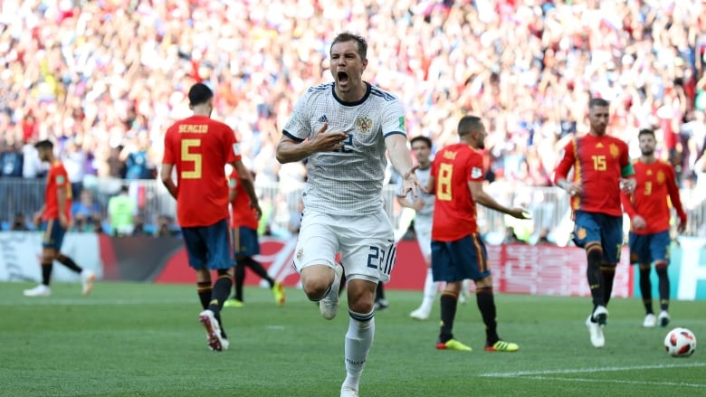 184777527e7 Artem Dzyuba of Russia celebrates after scoring his team's first goal din  their match against Spain on Sunday in Moscow, Russia. (Clive Rose/Getty  Images)