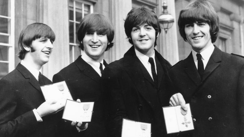 Beatles Ringo Starr John Lennon Paul McCartney And George Harrison Left To Right Smile As They Display The Member Of Order British Empire
