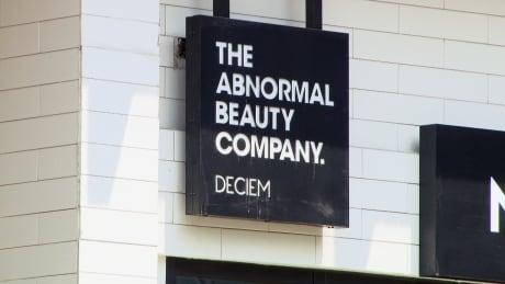 Deciem store sign