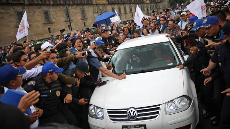 Mexicos President Elect Andres Manuel Lopez Obrador Leaves The National Palace With His Car Surrounded By Supporters And Press On Tuesday