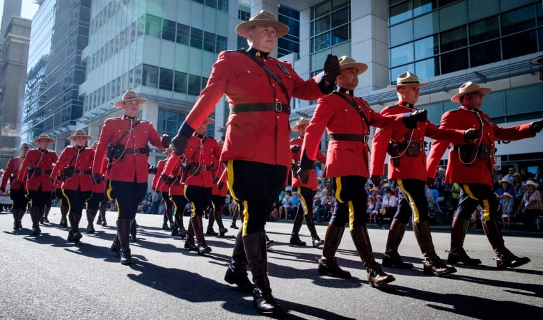 Members Of The Rcmp March During The Calgary Stampede