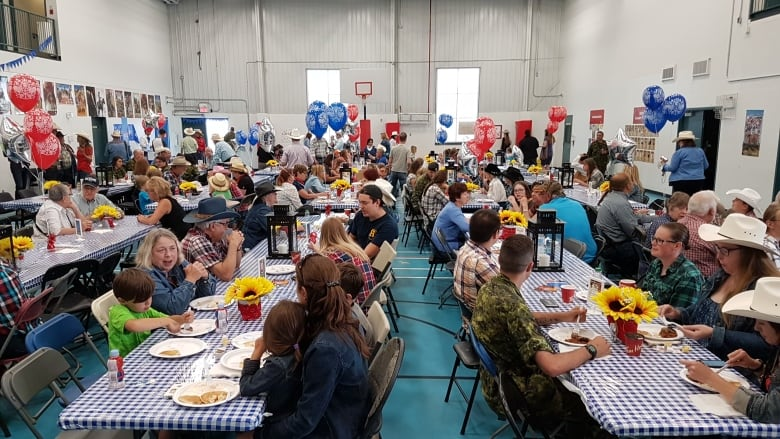 Attendees Enjoying A Pancake Breakfast At The Military