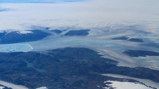 Watch a glacier half the size of Manhattan break off Greenland   CBC News