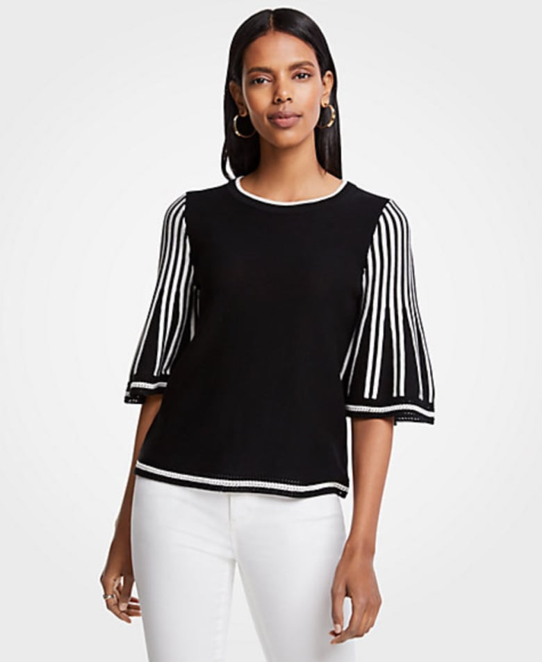07caa0f20d Simple and still a bit elevated. Choose a style like this black and white  sweater with detailing on the sleeves