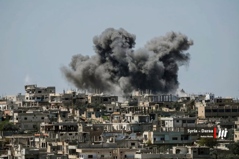 Smoke Rises Over Buildings That Were Hit By Syrian Government Forces Ardment In Daraa Province Southern Syria In Early July