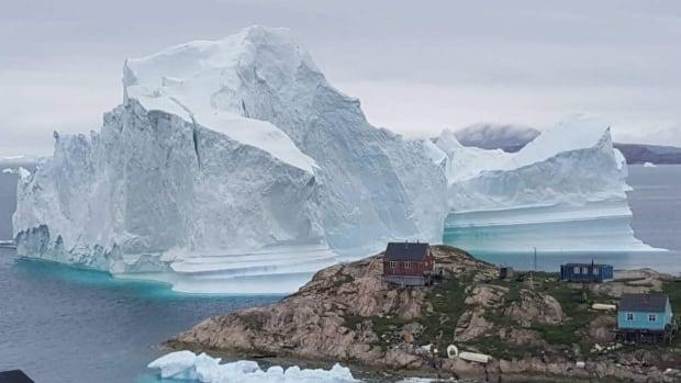 Greenland community on high alert as massive iceberg looms | CBC News