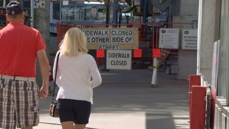 'Sidewalk closed': Busy construction steers pedestrians on multiple detours thumbnail