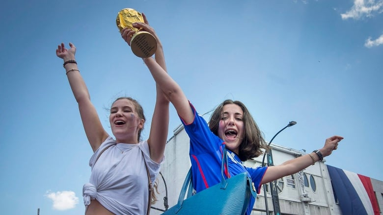 f8f6ad902b9 France soccer fans celebrate their team s World Cup victory in Montreal on  Sunday. (Peter McCabe Canadian Press)