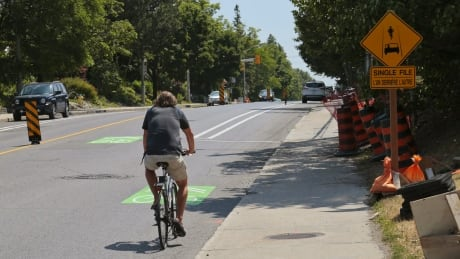 Harmer Avenue Detour - Cyclist on Holland Avenue