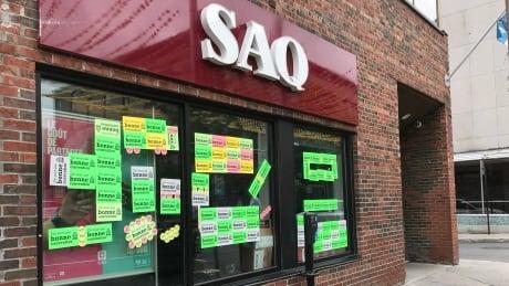 SAQ employees walk off job, shutting some stores | CBC